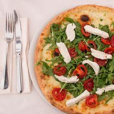 This is a classic Italian pizza at Ristorante Masseria in Mantua, Italy.