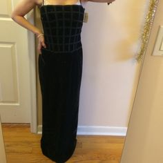 "GANTOS brand new black long velvet dress Has a great textured checkered top. Mean be worn with straps or tuck them in. Formal velvet dress. I'm 5 feet even abs if worn with 4-5"" heels it would be perfect in length. Bust is 15"". Hips are 14"" hips are 16"". Top measures 15.5"" and velvet bottom is 39"". Slit I'm back us 19"". Straps are 15"". Tag still attached and retails fir 178$. gantos Dresses Prom"