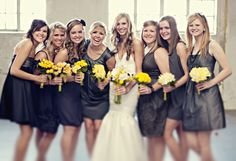 Gray wedding party... each with a different dress.  But with Pink flowers.