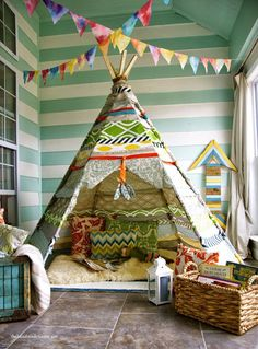This no-sew teepee is the perfect addition to any kids playroom. So much fun! From The Handmade Home | 10 Fun & Friendly Kids Playrooms ~ Tinyme Blog