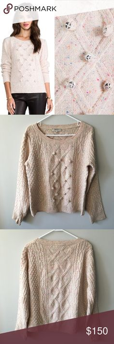 ✨HP✨ Milly Sparkle Sweater Adorable, versatile sweater by MILLY. ·  94% merino wool , 6% viscose ·  Hand wash cold ·  Speckled color-way throughout ·  Pom pom accents with flat stud accents along front ·  Rib knit edges Lightly used – no stains, holes, pulls, or pilling – in excellent, pre-owned condition. Bundle & save 💰! Retail price: $395. Sorry - 🚫 trades! Milly Sweaters Crew & Scoop Necks