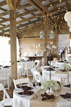 I like the lights and the baby's breath table settings, very simple and understated yet beautiful by desiree