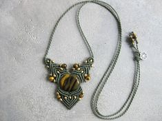 Dainty statement micro macrame necklace featuring Tiger Eye stone and brass beads accents. Hand crafted .. one knot at a time .. by micro macrame technique, this a unique and one-of-a-kind piece. Made with love and soul with waxed polyester strings for quality and durability. It is also