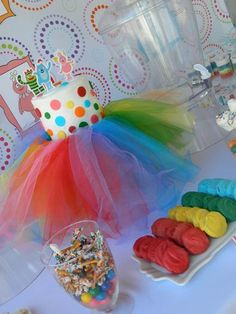 Love the tulle on the cake stand. Would be so cute in pink for a princess party!