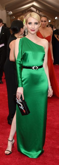 Going glam for the 2015 Met Gala: Emma Roberts in a custom, emerald-colored Ralph Lauren evening dress.