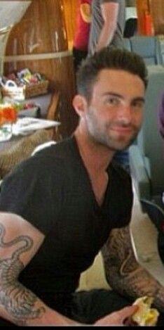 Adam Levine eating a sandwich