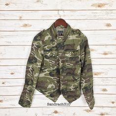 Asymmetrical camouflage anorak jacket Brand: Wet Seal Size: M  Color: Olive  New with tags  Zipper for closure on the middle  2 pockets on each side Gemstones on each top pockets  Zipper on collar  Fitted Asymmetrical anorak/ camouflage  No hood No Trade Jackets & Coats