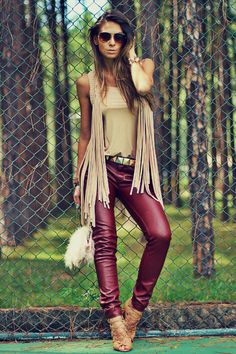 Love this ladies style!  Maroon leather pants, fringe vest with a tan cami...so gorgeous! Women's street style fashion clothing outfit for spring