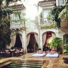 This looks like the courtyard of an italian villa, that opens up to the pool.  What an amazing look