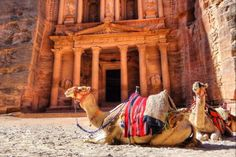 Al Khazneh or The Treasury is one of the most elaborate temples in the ancient Jordanian city of Petra. As with most of the other buildings in this ancient town, including the Monastery, this structure was carved out of a sandstone rock face. It has classical Greek-influenced architecture, and is a popular tourist attraction.