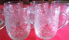 Vintage set of seven Crystal glass beverage / Mugs. from Princess House, Poinsettia Fantasia holiday design,embossed, etched in excellent condition.purchased at a estate sale.4 high, 23/4 at top 21/2at base. can be found at Home and Living,Kitchen and Dining, glass coffee mugs. Kitchen and serving.I have purchased several Pieces of this design,please check out my other listing and I will be happy to combine shipping