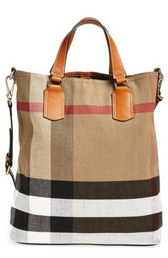 Free shipping and returns on Burberry Brit 'Medium Tottenham' Check Print Bucket Tote at Nordstrom.com. Classic checks and smooth leather trim add signature sophistication to an earthy canvas tote topped with an optional crossbody strap for effortless, on-the-go versatility. A snap-in zip pouch keeps your essentials organized while doubling as a convenient clutch.