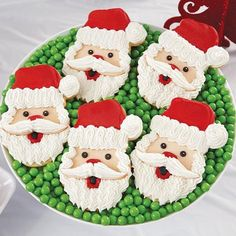 Santa Face Cookies - These easy-to-decorate cookies make Santa happy—along with everyone on your Christmas list. Use the Wilton Santa Face Cutter Set to make the cookie shapes, then decorate with Wilton Icing Pouches.