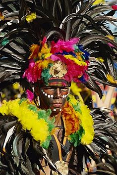 Portrait of a man with facial decoration and head-dress with feathers at Mardi Gras carnival, Dinagyang in Iloilo City on Panay Island, Philippines, Southeast Asia, Asia