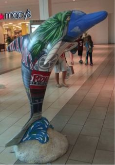 """Kale"" dolphin by artist ""Rasta"" Geary Taylor is on display at sponsor Westfield Countryside Mall in Clearwater."