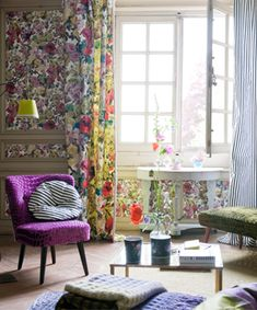 Feeling floral?  A mixture of adorable purples and yellows this wallpaper makes any room bright and cheery!