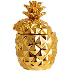 A candle housed in a metallic pineapple. | 47 Secret Santa Gifts Under $20 That Everyone Will Want