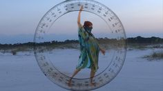 360° orbits around X, Y, and Z axes in a yoga practice on the beach. Tuning into my beacon at GC (Galactic Center) a centering grounding that makes me happy. The supergalaxy is perpendicular to that. I related it to my orbit yoga. Each hand starts with an energy connection to the largest aspects possible. All. It repeats with an energy connection to  the tiniest aspects possible. Nothing. The practice concludes with swing twists out around and into the heart in each direction.
