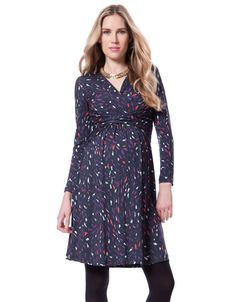 Soft stretch jersey   Flattering empire detailing   Long sleeves   Crossover V neckline for nursing   Above the knee    This printed Maternity Dress has a dark navy base with vibrant purple and red motifs creating a very on trend signature print.  The dress  has a cross front V neck line that will flatter your bust and highlight your empire line .  Made in the softest stretch jersey with gentle gathers through the skirt, it's designed to grow with you, offering a flexible fit through every…