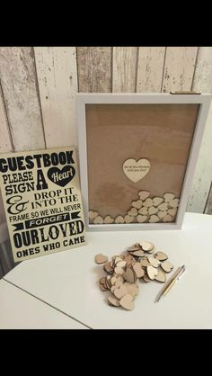 Replace the boring Guest book with a shadow box! Guests sign a heart and drop into frame to be sealed and framed!