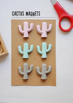 These are fridge or refrigerator magnets made of concrete by YCO the concrete jewelry studio. The cactuses are available in many colors and packs.   Cactus magnets refrigerator magnets concrete succulent magnets