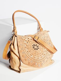 Ibiza Embellished Satchel | Italian made boho-inspired leather satchel featuring simple metal studs and shimmering stone embellishments for a touch of glam.    * Removable and adjustable long strap and short strap for a customized carry   * Lined inner with compartments for simple storing   * Foldover top with zipper closure