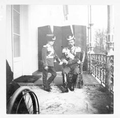 Nicholas II and Tsarevich Alexei in uniform on the balcony of the Alexander Palace in honor of the Romanov Tercentenary: 1913. Alexei was meant to look like he was posing for the photograph, but in fact he still could not straighten his leg from his attack of hemophilia at Spala the previous fall.