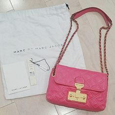 "MARC JACOBS Pink Single Quilted Shoulder Bag Baroque style. Soft quilted lambskin and secured with a gold logo-embossed pinch-lock. Pull-through straps can be converted to a single crossbody strap. Interior wall and cell phone pockets.  Color: Fuschia/Hot Pink/Barbie Pink  Size: 8"" W x 6"" H x 2"" D Strap drop: 11 1/2"" Crossbody strap drop: 21""  Comes with original tags, paperwork, dustbag, and key.  Used twice. Great condition!  Super rare! Original price = $795  Willing to sell lower on…"