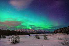 Aurora Borealis in Alaska. Beautiful green Northern light (Aurora Borealis) at Knik River in Alaska.