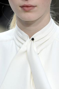 Blouse and pin.