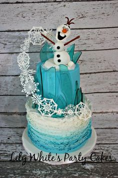 Frozen inspired cake - olaf is a bit creepy in this but i love the design!