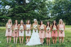 Bridesmaids chose their own dresses in different shades of pink. | Photo: Maxwell Monty Photography, Dress Designer: Lazaro, Floral Designer: Seventh Stem
