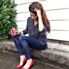 Navy polka dot blouse, high waisted dark jeans and cute red flats   Jillian Harris