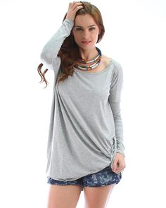 Start to feel like you could fly away on a gentle breeze in this super-soft oversized tunic. Comfortable and easy, you'll be free flowing through your day and even into evening should you opt to throw a smart blazer over this stylish piece.  This free-flowing tunic is long-sleeved and scoop necked; can be worn as a top or dress.  Made in the USA. 95% Rayon. 5% Spandex. Model wears a small/medium.  Colorways include: Navy, Sand, Black, Heather Grey, Royal Blue, Red, Lavender, Seafoam + Teal.
