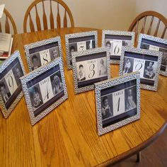 table numbers with photos of bride and groom at that age