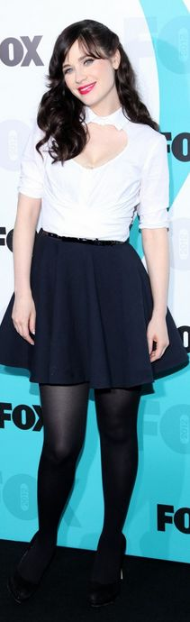 Who made Zooey Deschanel's black pumps, white cut out top, and black skirt that she wore in New York on May 14, 2012? Dress – Carven  Shoes – Miu Miu