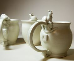 @Shannon Bellanca Nicole all the cute things in the world are overpriced. custom mug with cat thumb rest, via CedarPocket etsy