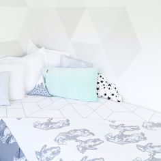 Grey, white and a pop of mint. Hello cute mountain cushion