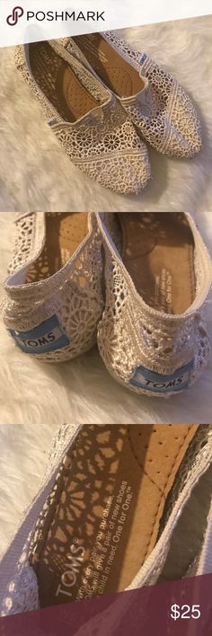 Toms white lace embroidered classic flats Toms white lace embroidered classic flats.  Great condition embroidered lace white times 6 1/2 W. Worn on a hand full of occasions last summer. Beautiful to dress up any simple outfit. Toms Shoes Flats & Loafers