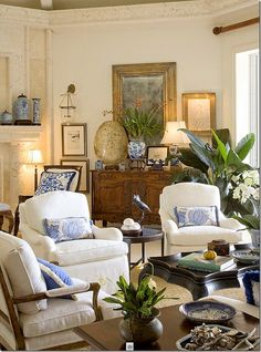 LOVE the color combination!!! The cool blue cushions keep an otherwise very warm room from feeling suffocating. The green plants are a must!