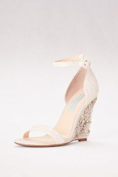Take your outfit to new heights. This eye-catching wedge sandal has a richly embellished heel and jacquard satin upper with skinny ankle strap.  By Blue by Betsey Johnson