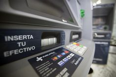 Estimate how much local currency you'll need, and take out that amount from an ATM upon arrival.
