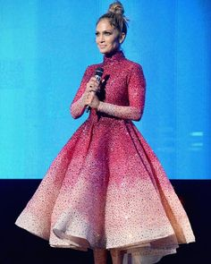 Host #JenniferLopez is pretty in pink at the #AMAs! From her 9 outfit changes last night, we think this stunning ombre tea-length dress covered in crystals by Filipino designer #MichaelCinco was the best, don't you think?
