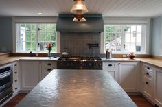 Hammered zinc island top made by Brooks Custom for @Archia Homes.