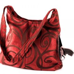 Very large conceal carry purse made from a plush (velveteen type)  upholstery with embossed design. The color is a beautiful rich wine color. 746809c3c369f