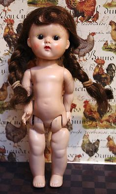 Cute Vogue Ginny SLW doll from the 1950's. Deep brown very nice wig and dark brown beautiful eyes. Comes to you nude to dress, although I have clothes in my other auctions...She's at my ebay now!