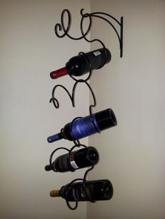 Hanging Wine Rack. It adds an interesting, artistic focal point to any wall and is practical, too! :)