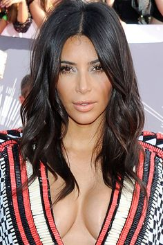 Kim Kardashian hit the scene with raven black locks but in recent years, has gone for a softer dark brown which complements her complexion. We love.