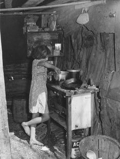 Oldest Child Fixing Supper. Homestead, Florida 1939