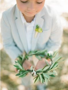 Wreaths are symbols of eternity as there is no beginning nor end. What better setting for your wedding bands which are also a promise of everlasting love? | 11 Fun Ring Bearer Boxes, Pillows, and More